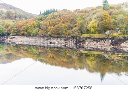 Trees, And Hill Reflected In Water, Autumn Fall.