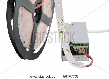 LED strip on the coil connected to the power adapter.