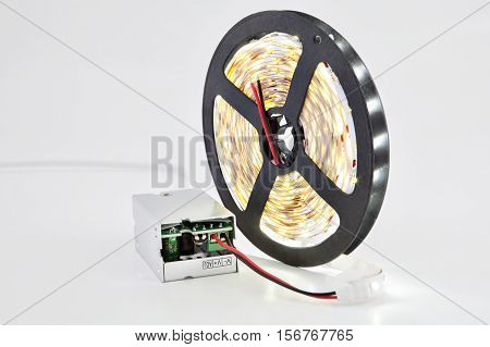 Luminescent diode LED tape on the coil attached to the DC converter.