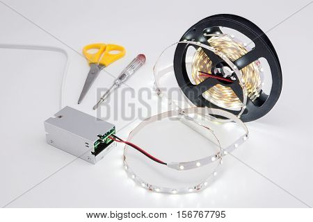 Roll tape and shining LED voltage converter.