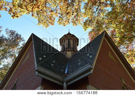 a slate roof that leads up to a cupola