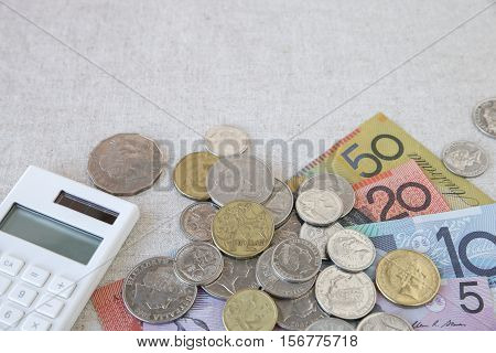 Australian money AUD with calculator selective focus copy space background