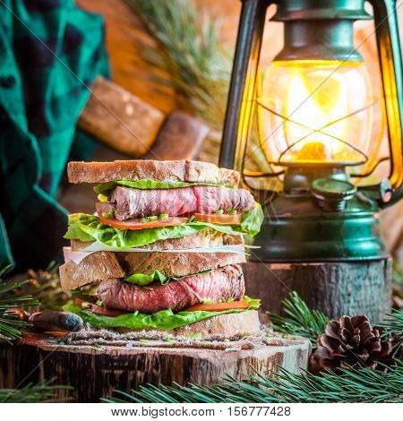Woodcutter Sandwich With Beef On Old Wooden Trunk