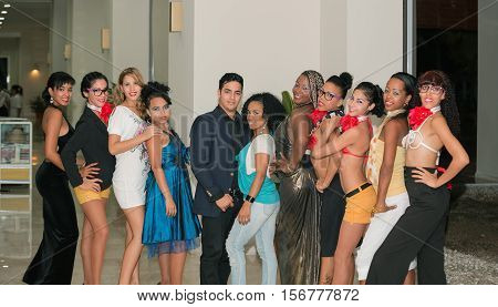 Santa Maria island, Eurostar hotel, Cuba, Nov. 24, 2013, Team of professional Cuban dancers standing in hallway and posing for photographer after their performance