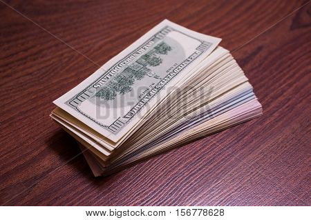 big pile of money. stack of money. related to money money on the wooden background
