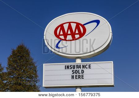 Kokomo - Circa November 2016: AAA Travel & Insurance Sign. The American Automobile Association Provides Roadside Assistance Jump Starts and Discounts to its Members II