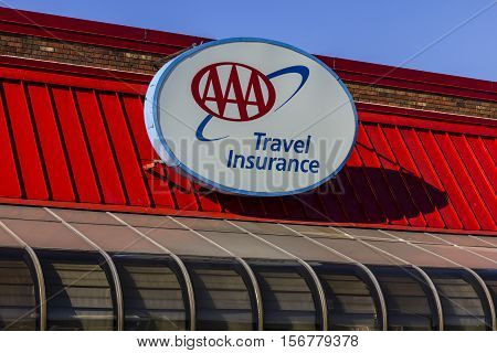 Kokomo - Circa November 2016: AAA Travel & Insurance Sign. The American Automobile Association Provides Roadside Assistance Jump Starts and Discounts to its Members III