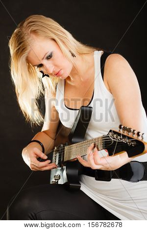 Woman Playing On Electric Guitar, Black Background