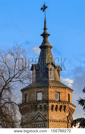Castle tower spire in front of blue sky
