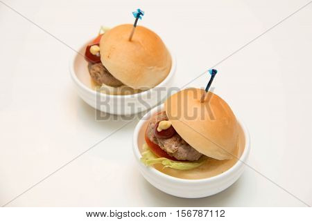 Appetizing mini chicken burgers Small burgers for catering service.
