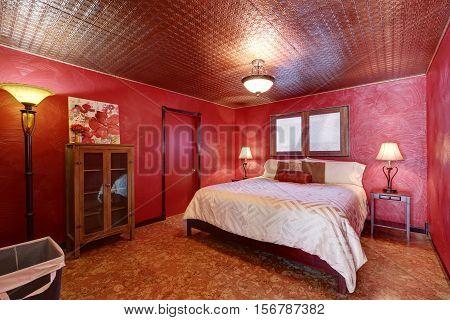 Red Bedroom With Queen Size Bed And Linoleum Floor.