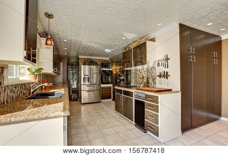Kitchen Room In Brown Tones With Storage Combination