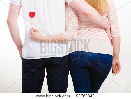 Rear View Of Hugging Couple.