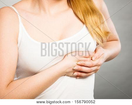 Woman Suffering From Sharp Chest Pain