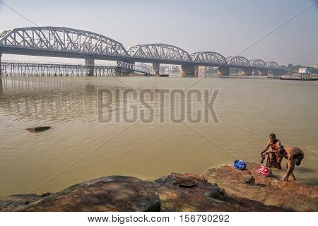 Local people taking a bath at the river Ganges at Dakshineshwar temple ghat close to Bally bridge, West Bengal, India. Photograph taken on November 12, 2016.