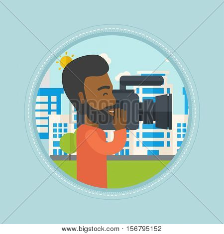 An african-american cameraman looking through movie camera. Cameraman with video camera in city. Cameraman shooting outdoor. Vector flat design illustration in the circle isolated on background.