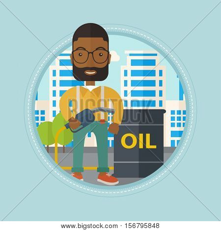 An african-american man standing near oil barrel. Oil worker holding gas pump nozzle on a city background. Oil industry concept. Vector flat design illustration in the circle isolated on background.