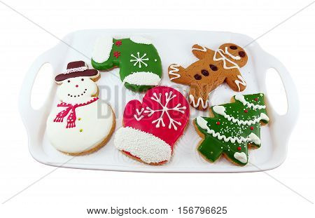 Christmas cookies; snow man Christmas tree ginger bread man in white tray