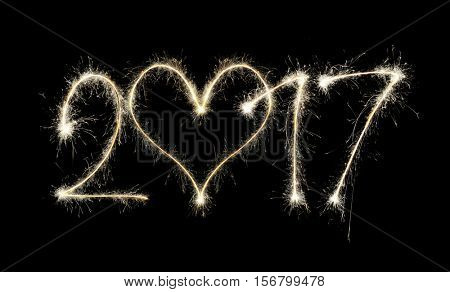 2017 writen with sparklers on black background, concept of New Year.