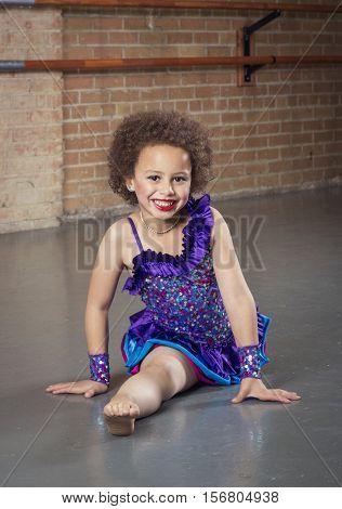 Diverse little dancer dancing at a dance studio