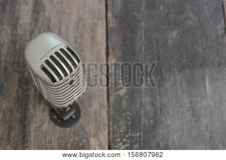 Retro microphone. Vintage style on the wooden floor background :Select focus with shallow depth of field.