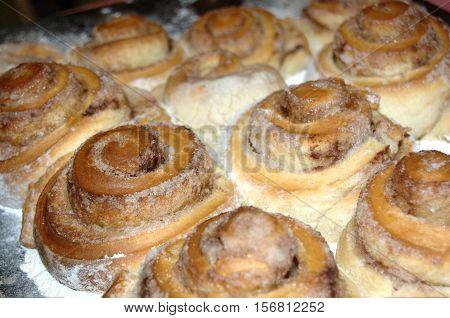 Sourdough cinnamon rolls sprinkled with crystal sugar