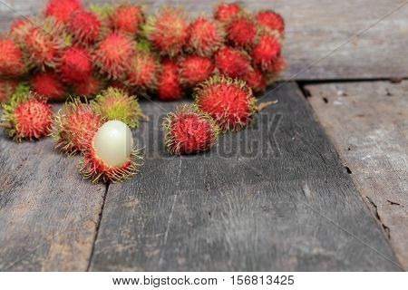 rambutan sweet fruit fresh on wood background :Select focus with shallow depth of field.