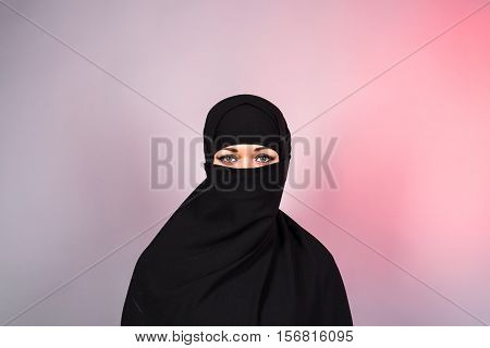 Beautiful Muslim girl wearing black burqa closeup.