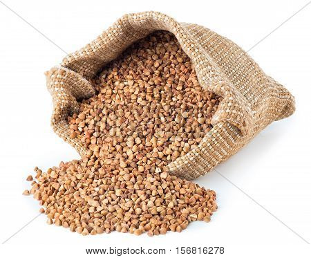 Buckwheat are scattered out of the bag isolated on white background. Buckwheat grains in burlap sack isolated on white background
