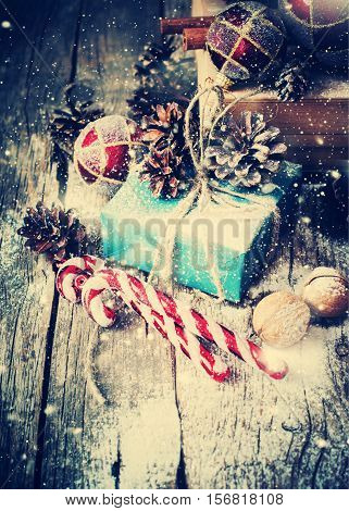 Box With Gifts On Wooden Background. Drawn Snow