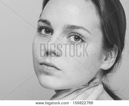 Beautiful Woman Face Portrait With Clean Skin. Cosmetology. Studio Shot. Black And White