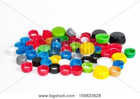 Colorful plastic bottle caps isolated on white background