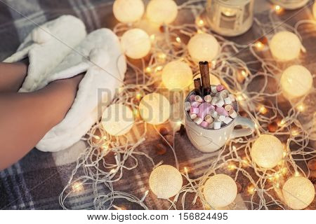 Woman Feet In Woollen Socks And Cup Of Hot Chocolate