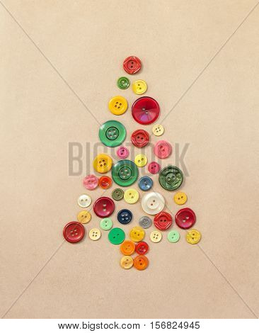 Christmas tree from colorful sewing buttons with copy space