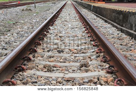 railway track on gravel with concrete rail ties : Select focus with shallow depth of field :