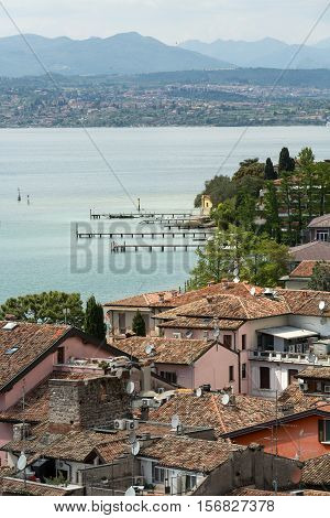 SIRMIONE ITALY - MAY 5 2016:View of colorful old building in Sirmione and Lake Garda from Scaliger castle wall Italy