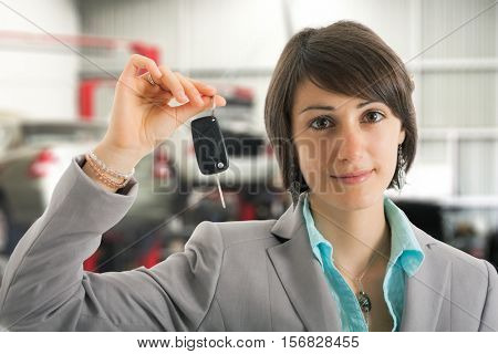 Woman servicing her car