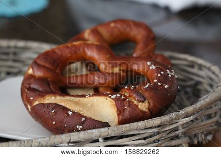Pretzels / The pretzel is a piquant or sweet pastry in the shape of a symmetrically entangled dough strand, especially in Southern Germany, Austria and Alsace.