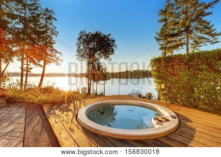 Exterior Of Waterfront House With Jacuzzi At The Back Yard.