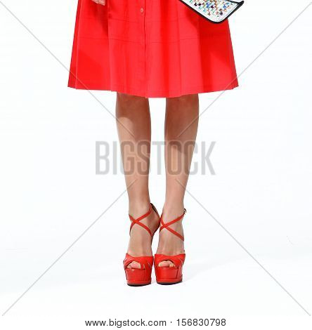 woman legs in red high heels shoes close up photo