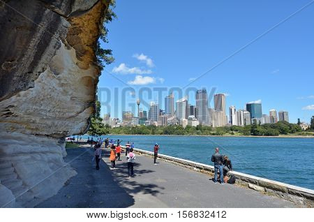 Sydney Australia - October 23 2016: Unrecognisable people look at Sydney central district skyline from the Rosa Botanic Gardens in Sydney New South Wales Australia
