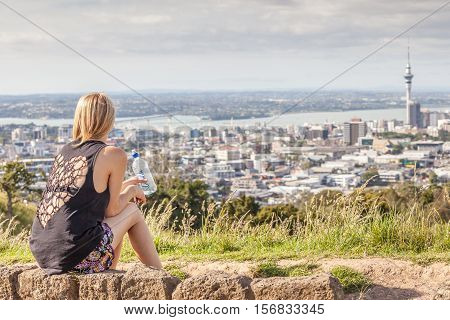 Auckland New Zealand- December 12 2013. Woman seeing the beautiful cityscape of Auckland.