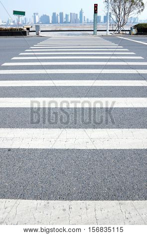 Crosswalk on the road also known as the zebra crossing.