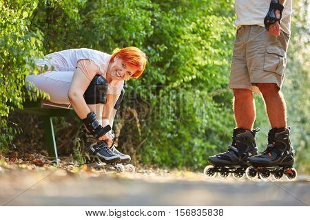 Active senior couple after rollerblading in the summer