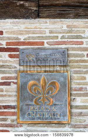 Vonnas, France - June 29, 2016: Relais and Chateaux symbol on Georges Blanc restaurant. Relais and Chateaux is a global fellowship of individually owned and operated luxury hotels and restaurants