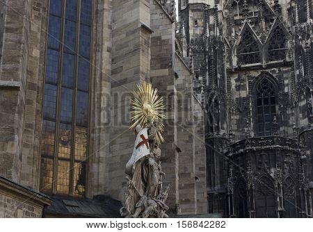 VIENNA, AUSTRIA - DECEMBER 31 2015: Architectural detail of St. Stephen's Cathedral facade with Capistran Chancel sculpture in Vienna Austria