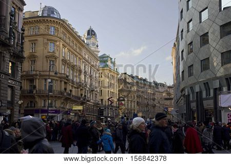 VIENNA, AUSTRIA - DECEMBER 31 2015: Graben street buildings and shops in Vienna at day time from Stephanplatz with many people along the street