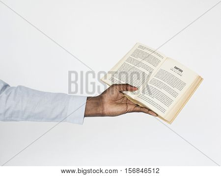 Human Hand Holding Novel Fiction Book Concept