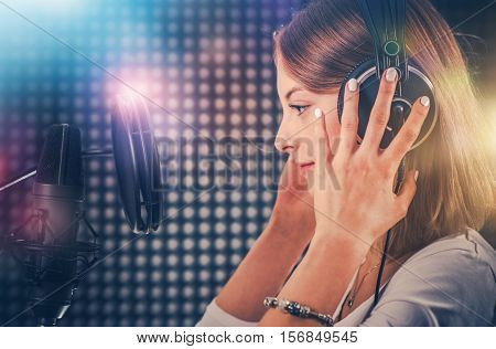 Young and Ambitious Singer in the Recording Studio. Caucasian Singer in Her 20s Recording a Song. Professional Sound Recording.