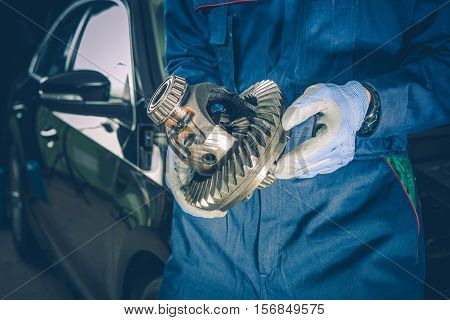 Broken Automotive Differential in a Hands of Car Mechanic. Replacement of Broken Car Elements. Car Maintenance.